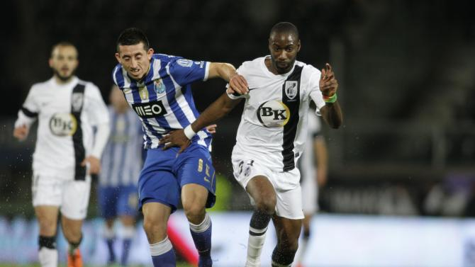 Guimaraes' Malonga fights for the ball with Porto's Herrera Lopez during their Portuguese Premier League soccer match in Guimaraes