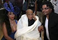 """Indian Bollywood veteran actor A.K. Hangal (centre) with actress Eleanor Sophie Hyat and designer Riyaz Ganji in Mumbai last year. Hangal, dubbed the """"grand old man"""" of Hindi cinema for his elderly roles, died on Sunday aged 95"""