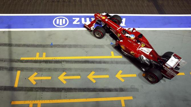 Ferrari Formula One driver Alonso drives during the qualifying session of the Singapore F1 Grand Prix in Singapore