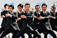 "Japanese dancing group ""World order"" promote business suits at Tokyo's Seibu department store earlier this month. Japan's disaster-hit economy will expand 2% this year amid a surge in reconstruction spending, but it could be tempered by energy shortages and Europe's debt woes, the IMF says"