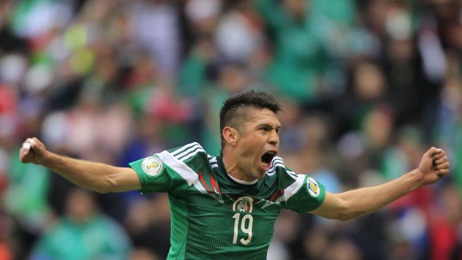 Mexico's Peralta celebrates scoring against New Zealand in their 2014 World Cup qualifying playoff first leg soccer match in Mexico City