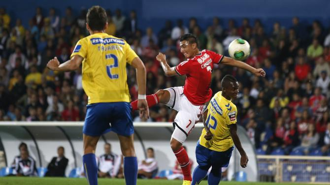 Benfica's Cardozo shoots to score a goal during Portuguese Premier League soccer match against Estoril, in Estoril