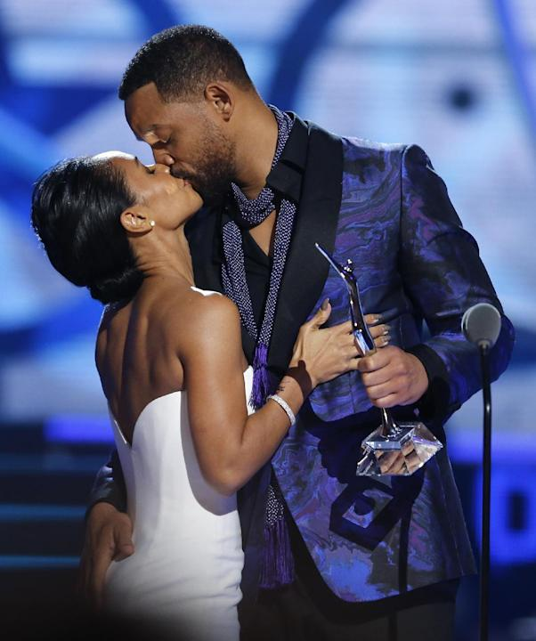 Actor Will Smith, right, gives a hug to his wife Jada Pinkett Smith before Will Smith gave Pinkett Smith the Star Power award  during a taping of the Black Girls Rock award ceremony at the New Jersey