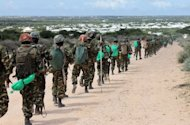 African Union troops move in a file just outside of the Somali capital Mogadishu
