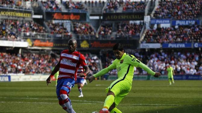 Barcelona's Suarez shoots next to Granada's Babin during their Spanish first division soccer match in Granada
