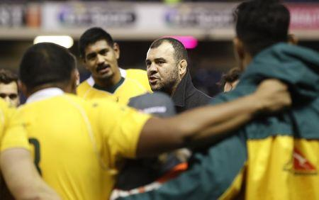 Australia coach Michael Cheika talks to players after victory