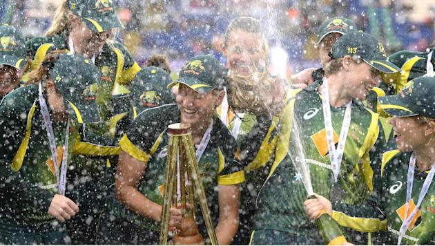 Australia's Meg Lanning celebrates with the Women's Ashes trophy