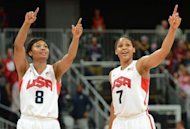 US guard Maya Moore (R) and US guard Angel McCoughtry celebrate after winning the women's quarter final basketball match USA vs Canada at the London 2012 Olympic Games at the North Greenwich arena in London. Australia and the United States, opponents in the past three Olympic women's basketball finals, will meet in a semi-final showdown after impressive triumphs on Tuesday