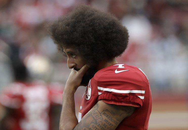 Colin Kaepernick is on the outside looking into the NFL world this spring. (AP)