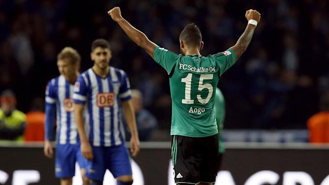 Schalke's Dennis Aogo, right, celebrates after the German first division Bundesliga soccer match between Hertha BSC  berlin and FC Schalke 04 in Berlin, Germany, Saturday, Nov. 2, 2013. Schalke defeated Hertha by 2-0