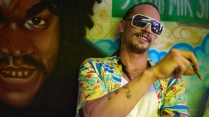 "This film image released by A24 Films shows James Franco in a scene from ""Spring Breakers."" (AP Photo/A24 Films, Michael Muller)"