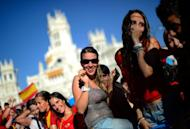Supporters celebrate as the Spanish national football team arrives on Cibeles Square after parading through Madrid, a day after it won the final match of the Euro 2012 championships 4-0 against Italy in Kiev