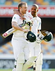South African batsmen Vernon Philander (R) and AB de Villiers walk off the ground on day five of their first Test against Australia. At the close after trailing by 115 runs on the first innings, South Africa were 166 for five with de Villiers not out 29 and Philander not out one
