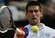 Serbia's Novak Djokovic returns a ball during his quarter-finals match against France's Jo-Wilfried Tsonga at the ATP Rome tournament on May 18. Djokovic's bid to become the first man in 43 years to hold all four Grand Slam titles at the same time hit its first hurdle when Roger Federer became a potential French Open semi-final opponent
