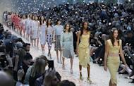 Models present a creations from the Burberry Prorsum Spring/Summer 2014 collection during London Fashion Week September 16, 2013. REUTERS/Suzanne Plunkett