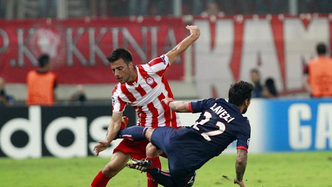 Andreas Samaris of Olympiakos, left, and Ezequiel Lavezi of Paris Saint Germain fight for the ball during the soccer Champions League group C match between Olympiakos and Paris Saint Germain in Piraeus, Greece, Tuesday, Sept. 17, 2013