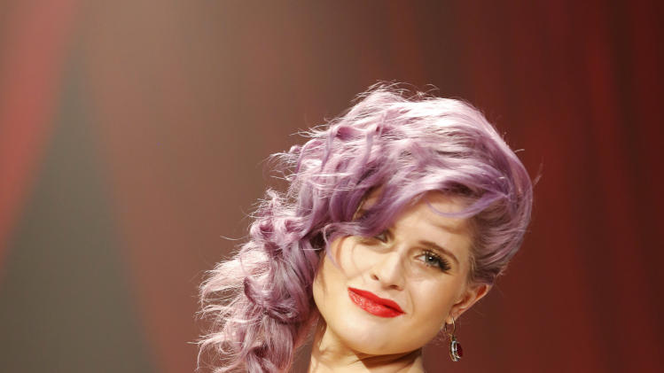 Kelly Osbourne walks the runway at the Red Dress Collection 2013 Fashion Show, on Wednesday, Feb. 6, 2013 in New York. (Photo by John Minchillo/Invision/AP)