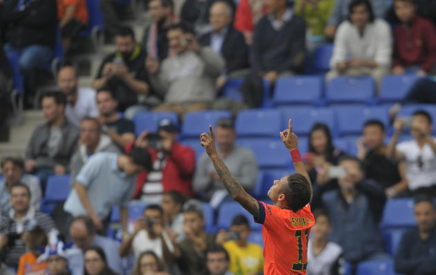 FC Barcelona's Neymar, from Brazil, reacts after scoring against Espanyol during a Spanish La Liga soccer match at Cornella-El Prat stadium in Cornella Llobregat, Spain, Saturday, April 25, 2015.