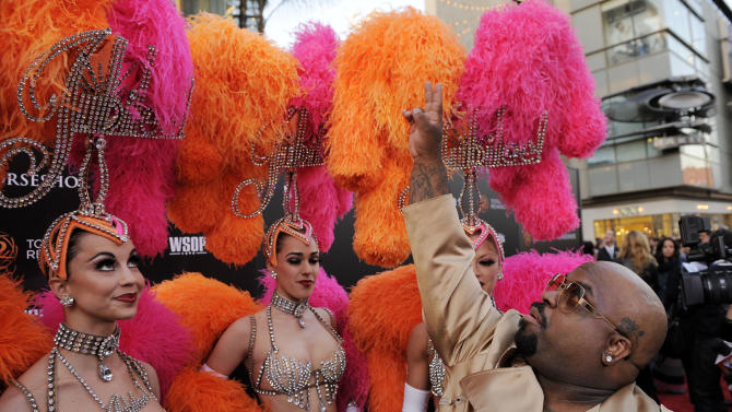 "Singer Cee Lo Green acknowledges fans overhead as he arrives with the Jubilee! showgirls at the Caesars Entertainment ""Escape To Total Rewards"" concert in Los Angeles, Thursday, March 1, 2012. Simultaneous concert events were held in New York, Chicago, New Orleans and Los Angeles. (AP Photo/Chris Pizzello)"