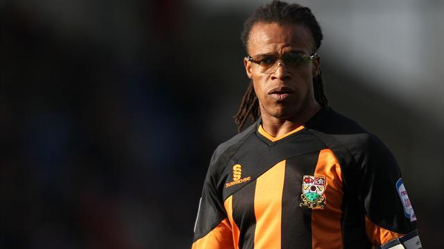 Football - Davids refuses to get carried away