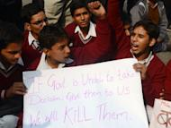 Indian school students shout anti-government slogans during a protest calling for better safety for women following the rape of a student in the Indian capital, in New Delhi on December 26, 2012. India's government ordered a special inquiry Wednesday into the gang-rape of a student which sparked mass protests, as police announced the arrest of 10 men over another multiple sex assault