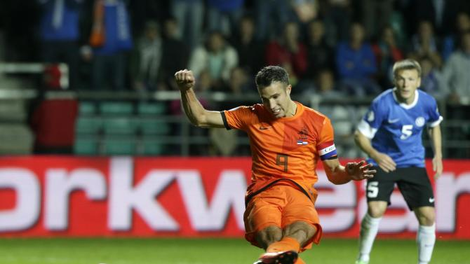 Estonia's Kruglov looks on as the Netherlands' van Persie scores a penalty shot during their World Cup 2014 group D qualifying soccer match in Tallinn