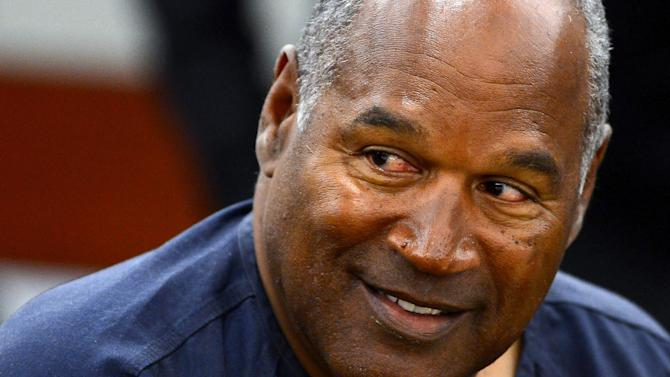 O. J. Simpson appears for the second day of an evidentiary hearing in Clark County District Court, Tuesday, May 14, 2013 in Las Vegas.  The hearing is aimed at proving Simpson's trial lawyer, Yale Galanter,  had conflicted interests and shouldn't have handled Simpson's case. Simpson is serving nine to 33 years in prison for his 2008 conviction in the armed robbery of two sports memorabilia dealers in a Las Vegas hotel room. (AP Photo/Ethan Miller, Pool)