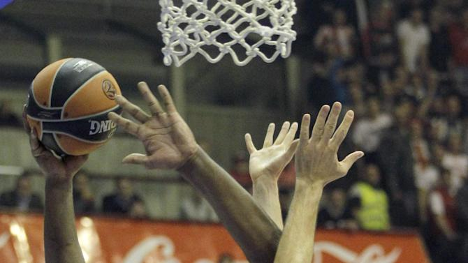 Sofoklis Schortsanitis of Maccabi Electra Tel Aviv, left challenges for the ball with Red Star's Ivan Radenovic, right and Luka Mitrovic during their Round 7, Group D, Euroleague basketball match in Belgrade, Serbia, Thursday, Nov. 28, 2013