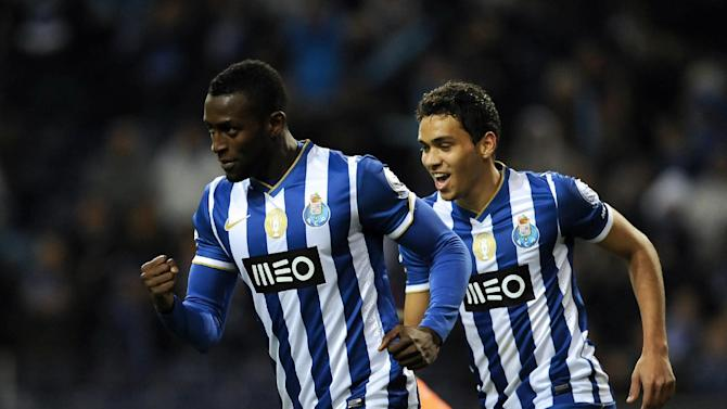 FC Porto's Jackson Martinez, from Colombia, celebrates after scoring the opening goal with Carlos Eduardo, right, from Brazil against Vitoria Setubal in a Portuguese League soccer match at the Dragao Stadium in Porto, Portugal, Sunday, Jan. 19, 2014. (AP Photo / Paulo Duarte)