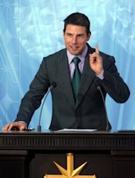 "Tom Cruise, seen here speaking during the inauguration of the Church of Scientology in Madrid, in 2004. Citing unnamed sources, TMZ.com website claims Katie Holmes filed for divorce mainly over Cruise's ties to Scientology, ""fearing that Tom would drag Suri (their daughter) deep into the church."""