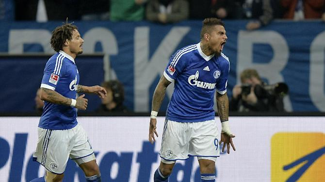 Schalke's Kevin-Prince Boateng, right, celebrates  after scoring during the German Bundesliga soccer  match between FC Schalke 04 and Werder Bremen in Gelsenkirchen, Germany, Saturday, Nov. 9, 2013