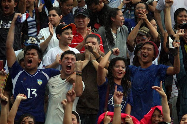 Pinoy fans show a variety of emotions during a football game in Manila. (File Photo by Marlo Cueto, NPPA Images)