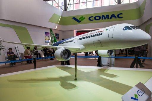 A model of the Comac C919 passenger jet is displayed during the 9th China International Aviation and Aerospace Exhibition in Zhuhai on November 13, 2012. China's home-grown passenger plane was only a model at the country's premier airshow, but a growing number of orders show Beijing's drive to challenge the dominance of Boeing and Airbus.