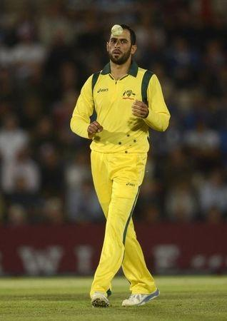 Australia's Fawad Ahmed tosses the ball during the first T20 international against England at the Rose Bowl cricket ground, Southampton