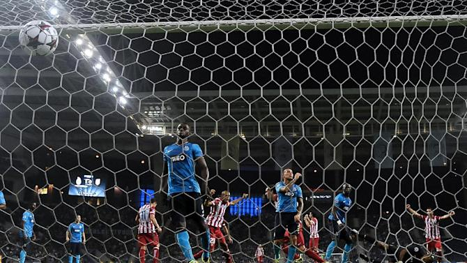Atletico's Diego Godin, center right, celebrates with Leo Baptistao after scoring his side's first goal during the Champions League group G soccer match between FC Porto and Atletico de Madrid Tuesday, Oct. 1, 2013, at the Dragao stadium in Porto, northern Portugal. Atletico 2-1