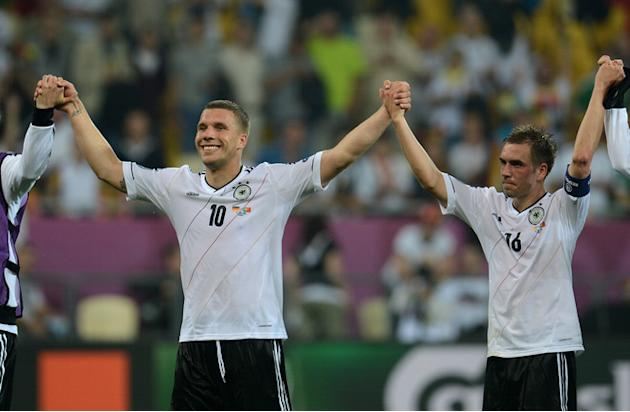 German Forward Lukas Podolski (L) And German Defender Philipp Lahm Celebrate AFP/Getty Images