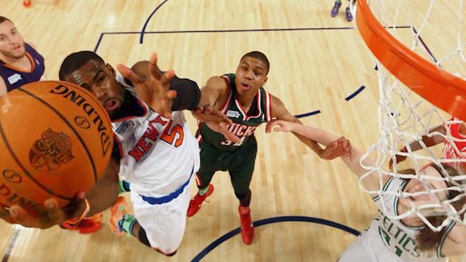 Team Webber's Tim Hardaway Jr. Of the New York Knicks heads to the hoop as Team Hill's Giannis Antetokounmpo of the Milwaukee Bucks (34) looks on during the Rising Star NBA All Star Challenge Basketball game,, Friday, Feb. 14, 2014, in New Orleans