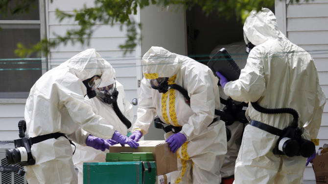 Federal agents wearing hazardous material suits and breathing apparatus inspect the home and possessions in the West Hills Subdivision house of Paul Kevin Curtis in Corinth, Miss., Friday, April 19, 2013. Curtis is in custody under the suspicion of sending letters covered in ricin to the U.S. President Barack Obama and U.S. Sen. Roger Wicker, R-Miss. (AP Photo/Rogelio V. Solis)