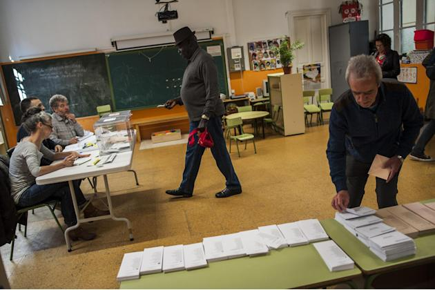 A Senegal African with Spain nationality, center, arrives to vote at a polling station, in Pamplona northern Spain, Sunday, May 24, 2015.  Spain could be set for a political upheaval in key local elec