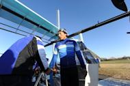 """Japanese professional cyclist Kazuhiro Yamamoto exits the cockpit of a man-powered airplane """"Gokuraku-tonbo"""" (Happy-go-lucky), produced by Yamaha Motor engineers belonging to """"Team Aeroscepsy"""" at the Honda airport in suburban Tokyo on December 2. The team hopes to beat the world record for a human-propelled plane"""