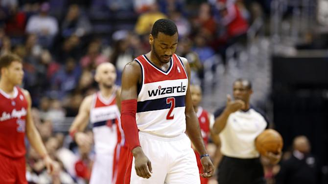 Washington Wizards point guard John Wall (2) walks to the other end of the court in the first half of an NBA basketball game against the Los Angeles Clippers, Saturday, Dec. 14, 2013, in Washington. The Clippers won 113-97