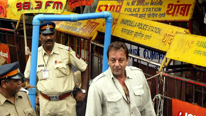FILE - In this June 19, 2007 file photo, Bollywood actor Sanjay Dutt, center, is frisked by a policeman upon his arrival at a special court trying the cases of those accused in the 1993 Mumbai bombings in Mumbai, India. India's Supreme Court has sentenced Dutt to five years in jail for illegal weapons possession in a case linked to the 1993 bombing that killed 257 people in Mumbai. The court on Thursday, March 21, 2013, ordered Dutt to surrender to police within four weeks on the charge of possessing three automatic rifles and a pistol that had been supplied to him by men subsequently convicted in the bombing. (AP Photo/Gautam Singh, File)
