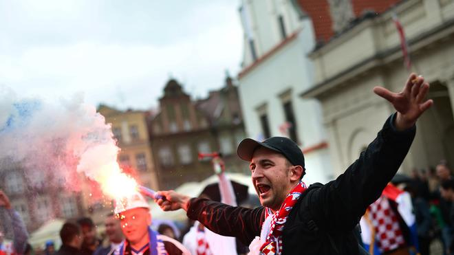 TOPSHOTS A Croatian Fan Lights A Torch At The Central Square In Poznan On June 14, 2012, AFP/Getty Images