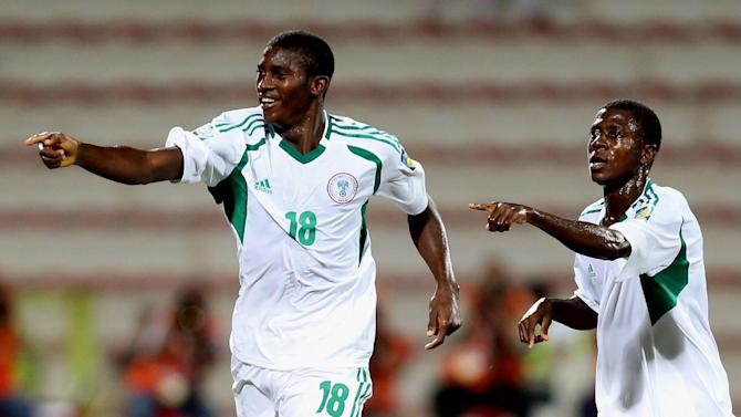 Taiwo Awoniyi of Nigeria, left, celebrates after scoring a goal against Sweden during a semifinal soccer match of the World Cup U-17 at Rashid stadium in Dubai, United Arab Emirates, Tuesday, Nov. 5, 2013. (AP Photo)