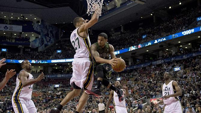 Toronto Raptors guard D.J. Augustin goes to a baskets against Utah Jazz Mike Harris (33), Rudy Gobert (27), John Lucas III (5) and Ian Clark (21) during the second half of an NBA basketball game in Toronto on Saturday, Nov. 9, 2013