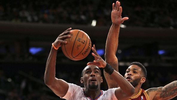 Cleveland Cavaliers' Alonzo Gee, right, fouls New York Knicks' Tim Hardaway Jr. during the first half of an NBA basketball game at Madison Square Garden, Sunday, March 23, 2014, in New York