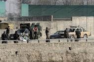 Afghan National Army soldiers and security personnel pictured at the site of a suicide attack, next to the ministry of defence in Kabul, on March 9, 2013. The blast came during a visit to the Afghan capital by new US Defense Secretary Chuck Hagel