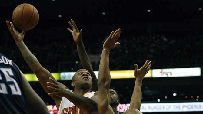 Phoenix Suns small forward P.J. Tucker (17) shoots over Charlotte Bobcats center Bismack Biyombo (0) in the third quarter during an NBA basketball game on Saturday, Feb. 1, 2014, in Phoenix