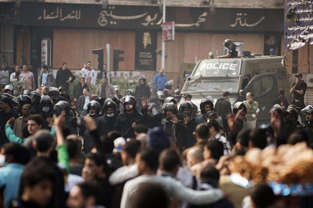 Egyptians riot police stand by during a face off with protesters on November 27.