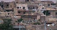 An image grab taken from a video released by the United Nations Supervision Mission in Syria (UNSMIS) shows shelled houses in the central flashpoint city of Homs.